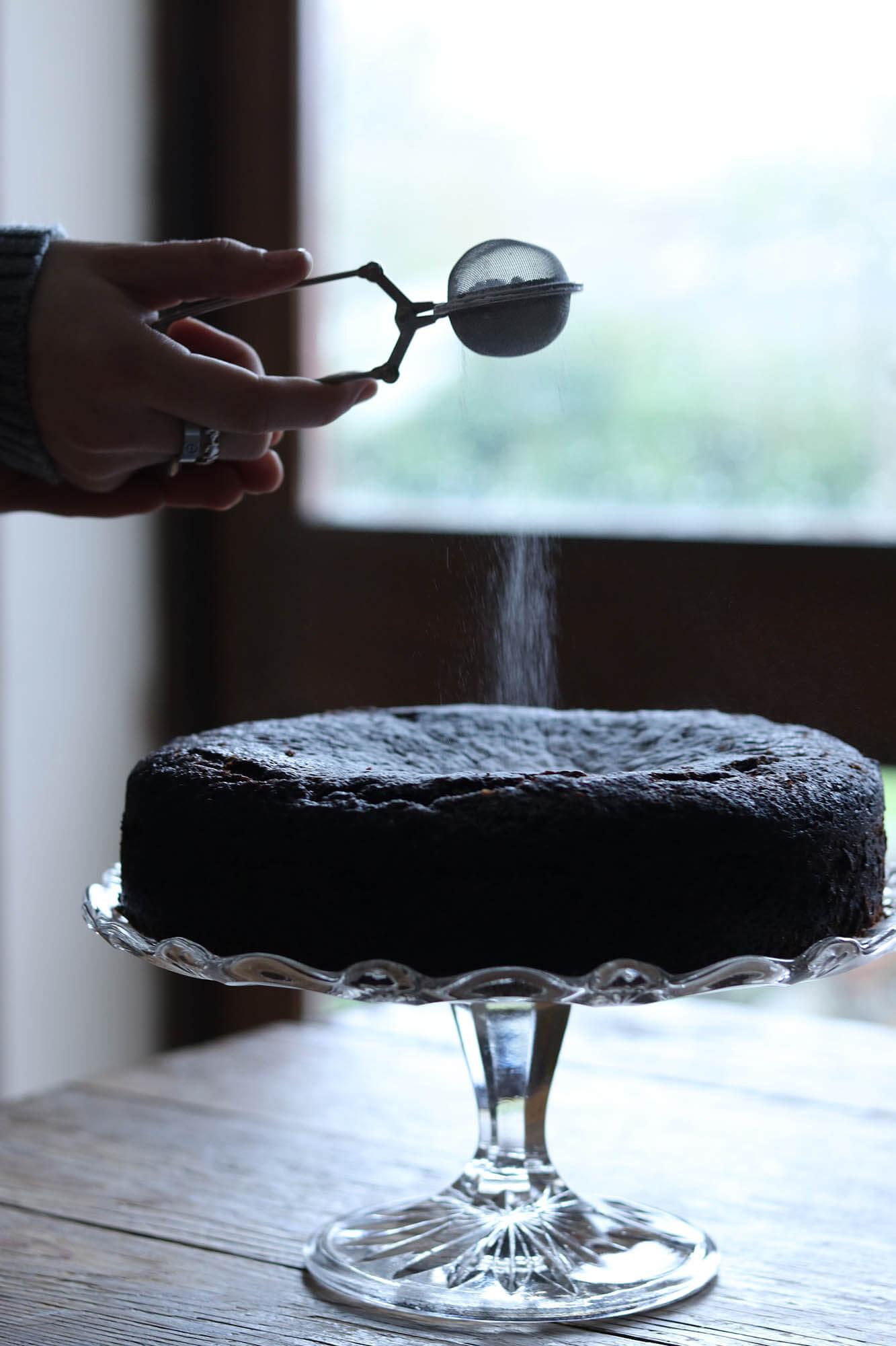 Beast cake getting a dusting of icing sugar