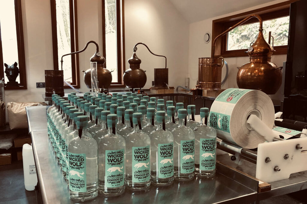 The distillery and bottles of Wicked Wolf Gin