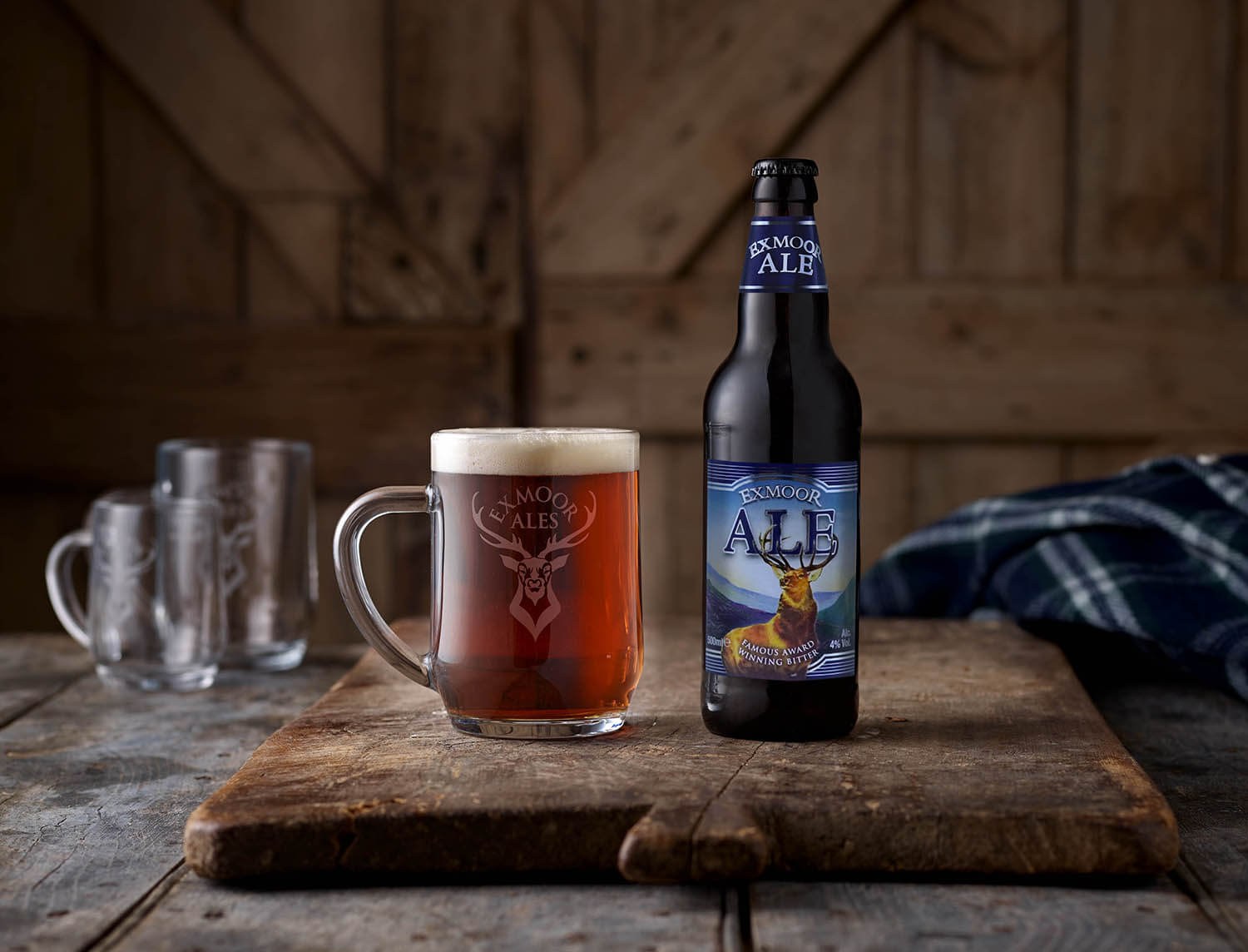 Bottle of Exmoor Ale and a full glass tankard