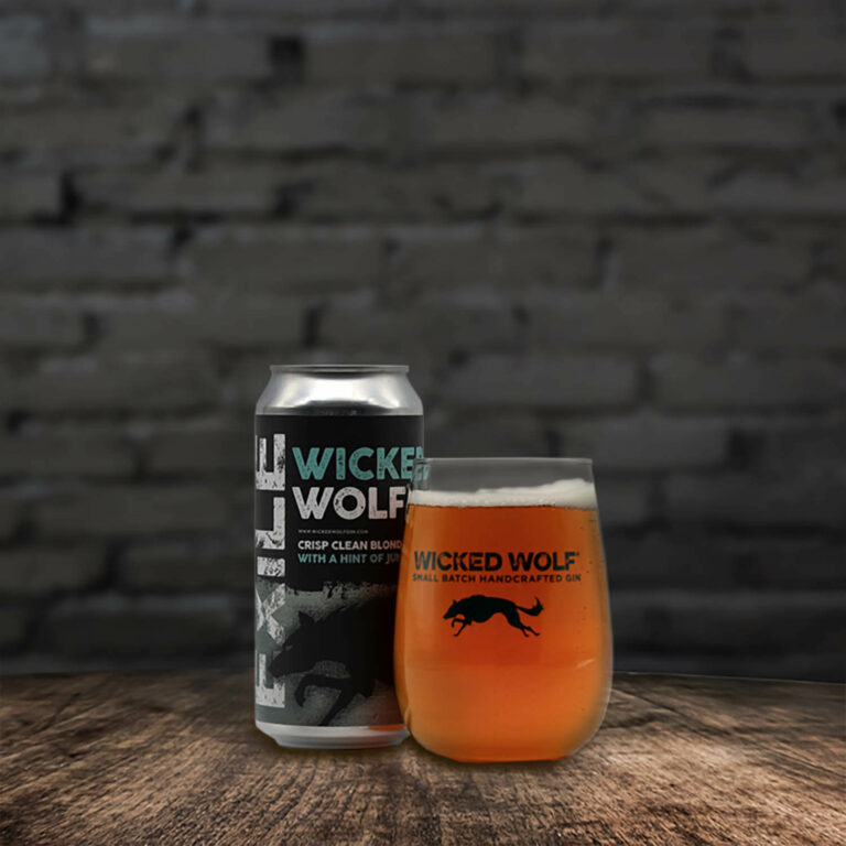 Can of Wicked Wolf Ale next to a full glass of beer