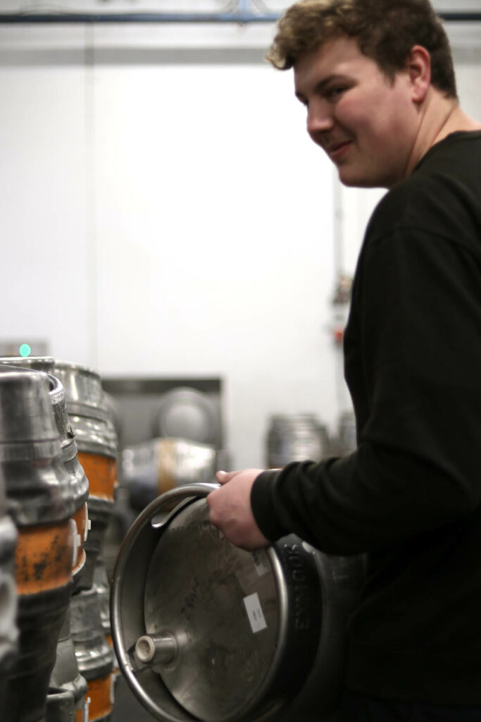 Employee carrying a beer keg